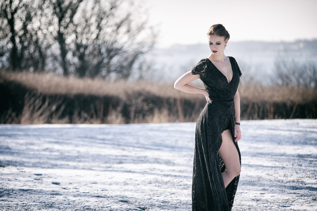 Model-in-black-dress in-snow