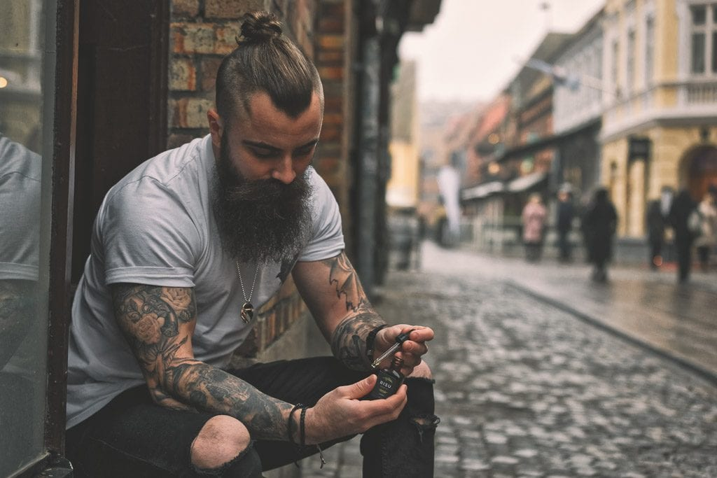 man-with-tattoos-and-beard