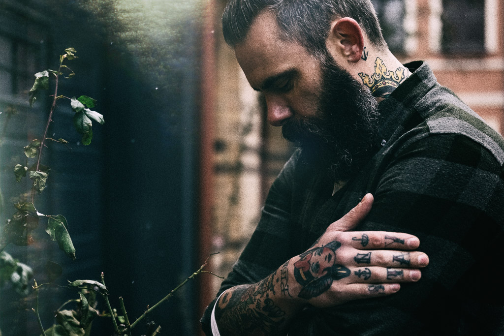man-with-beard-and-tattoos