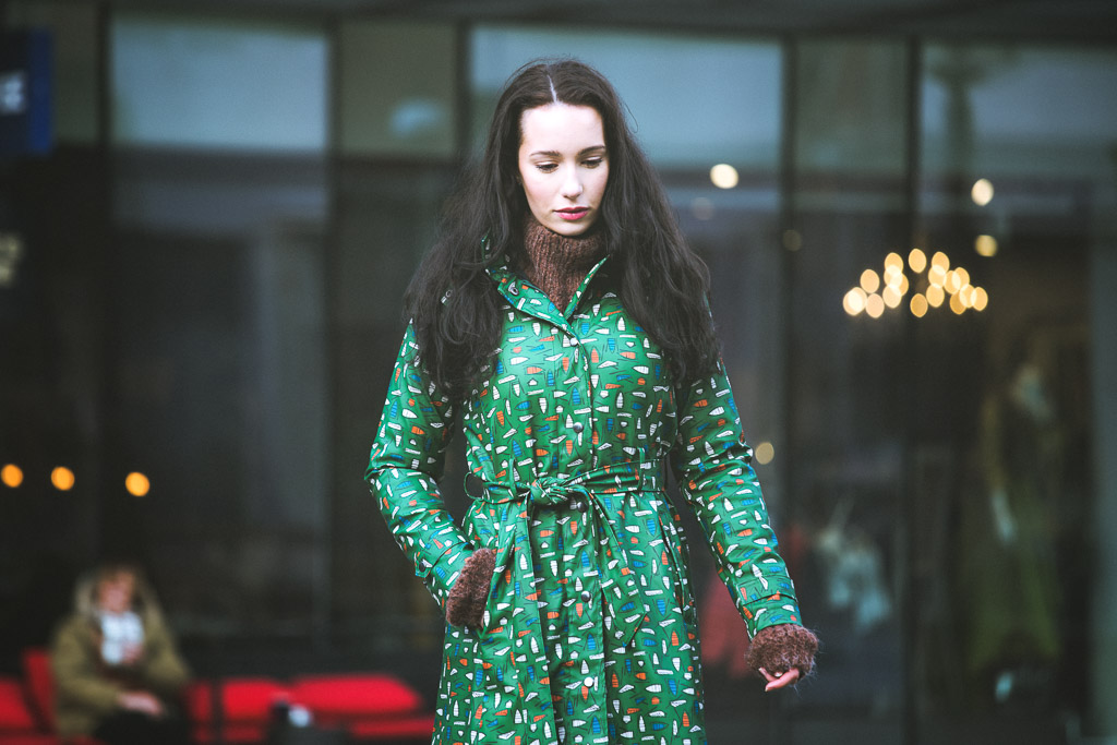 woman-dressed-in-green-raincoat