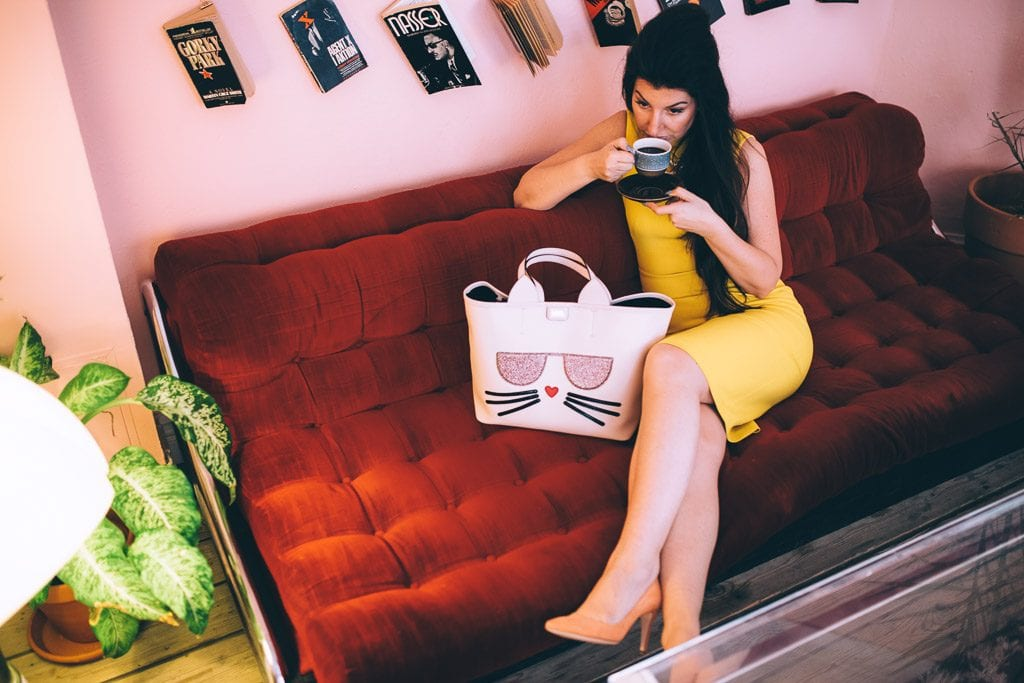 yellow-dress-on-red-sofa