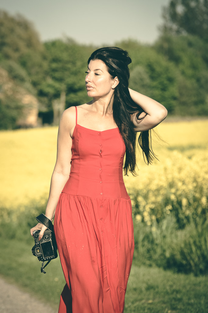 Female-photographer-in-red-dress