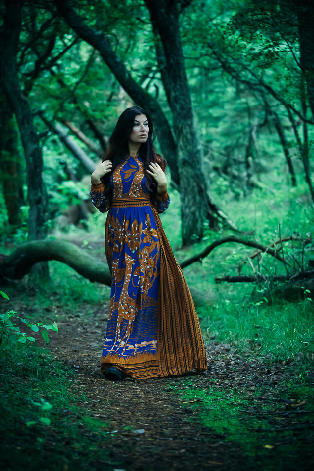 woman-walking-in-magical-forest