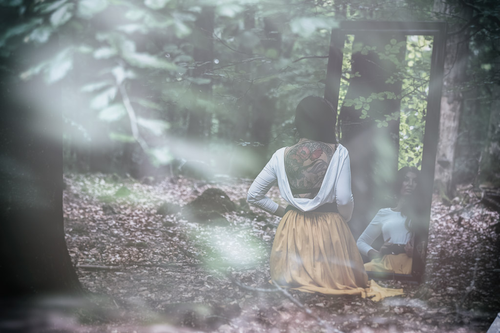 woman-and-mirror-in-forest